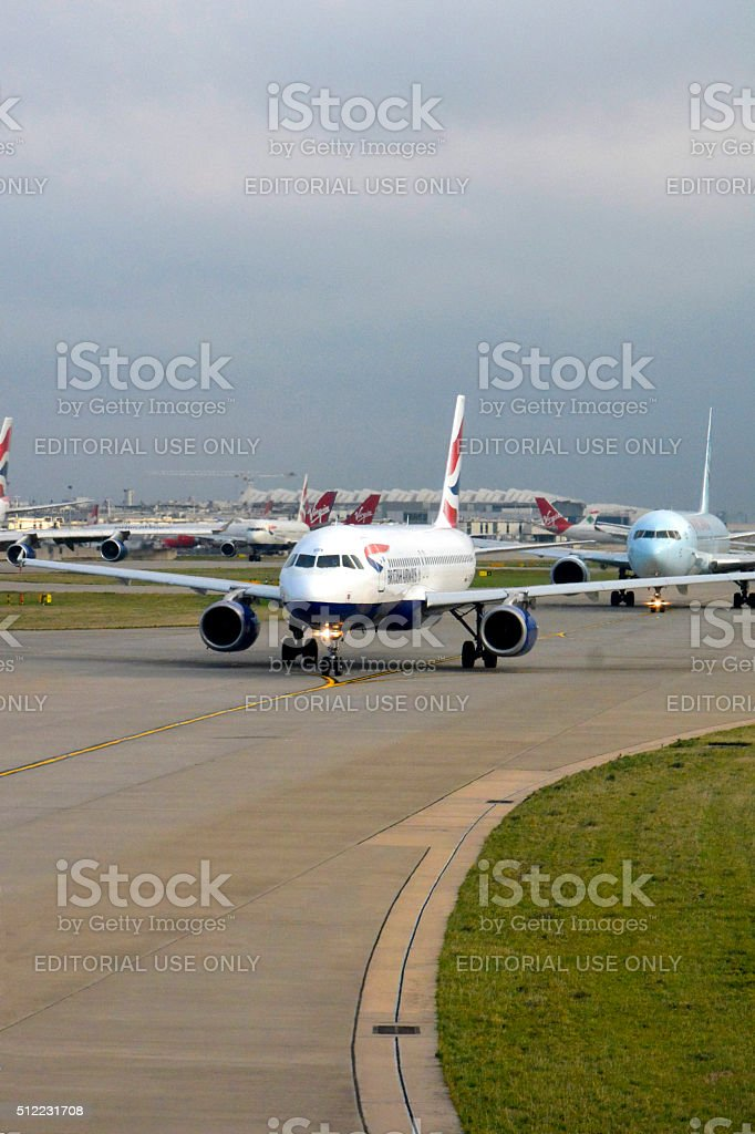 Planes waiting to take off from London heathrow airport stock photo