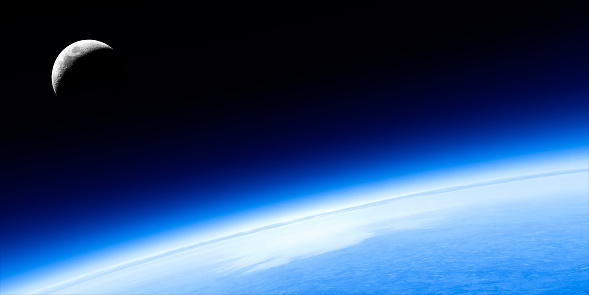 planet earth in close-up with crescent moon, panoramic frame