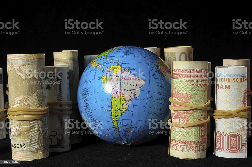 Planet Earth and Rolled Money royalty-free stock photo