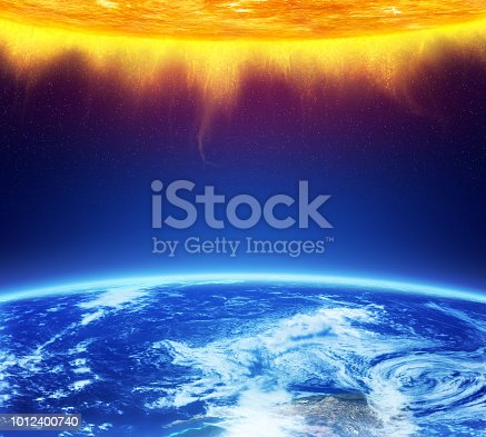 istock Planet Earth and Sun 1012400740