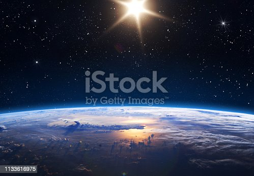 Earth, Sun and Space. Planet earth with sunrise in the space. Elements of this image furnished by NASA.