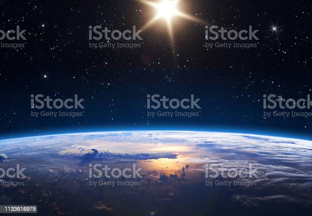 Photo of Planet Earth and Sun.