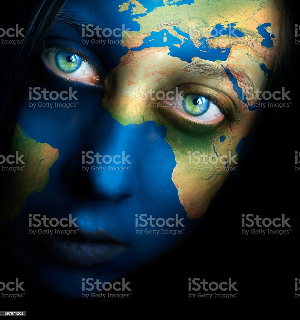Planet earth and woman face stock photo