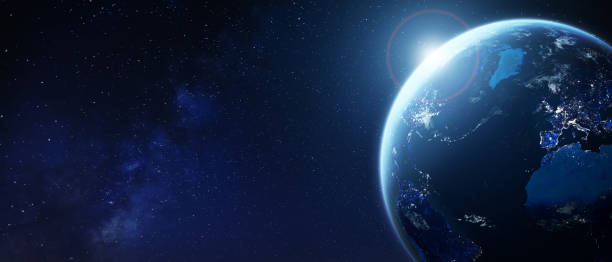 Planet Earth from space with city lights in Europe and North America. World with sun and star background. Banner for global business, international finance, fintech technology, elements from NASA stock photo