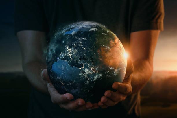 Planetenerde in Menschenhand – Foto