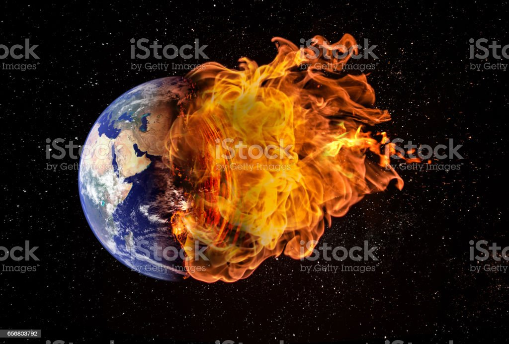 Planet Earth in Outer Space Engulfed in Flames stock photo