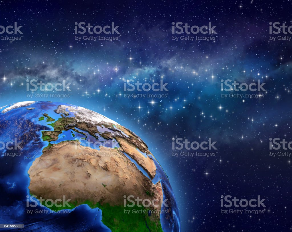 Planet Earth in star field stock photo