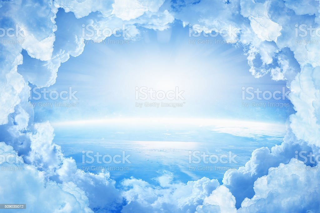 Planet Earth in white clouds stock photo