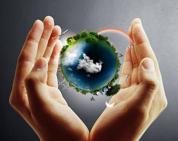 planet earth shown between the hands of a person - recycling heart bildbanksfoton och bilder