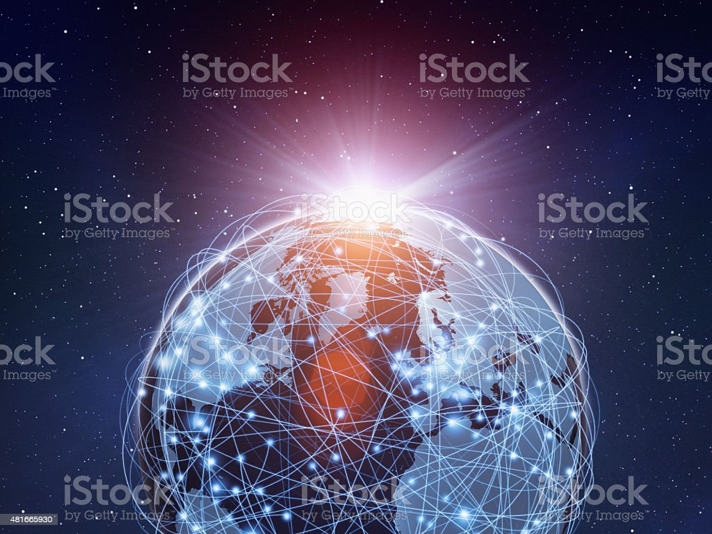 Planet Earth sourrounded by a global computer network, sun rising stock photo