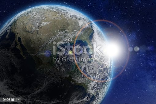 989624498istockphoto Planet Earth viewed from space, sun. World image from NASA 949616114