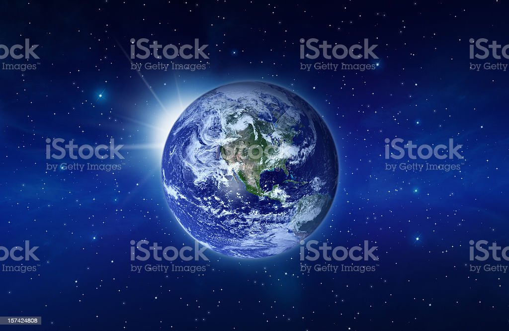Planet Earth with Rising Sun behind - Royalty-free Astronomy Stock Photo