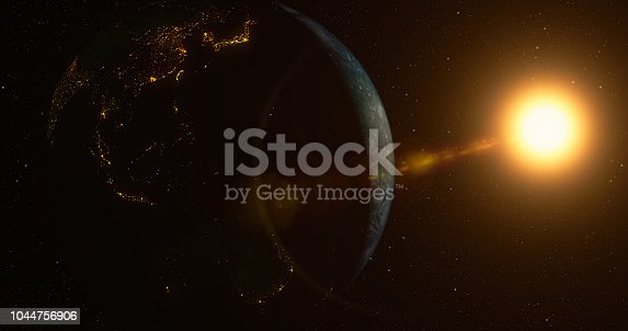istock Planet Earth with sun 1044756906