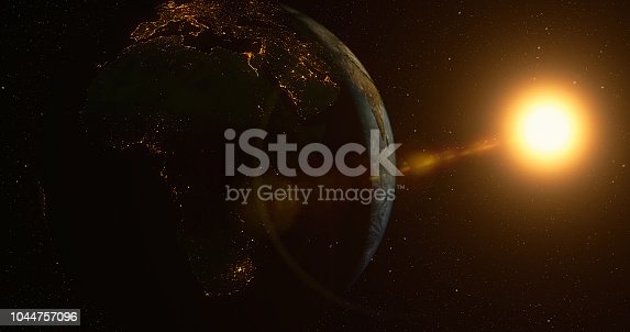 istock Planet Earth with sun 1044757096