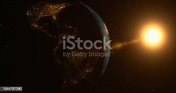 istock Planet Earth with sun 1044757290
