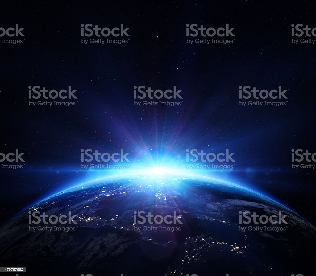 planet earth with sunrise in the space stock photo