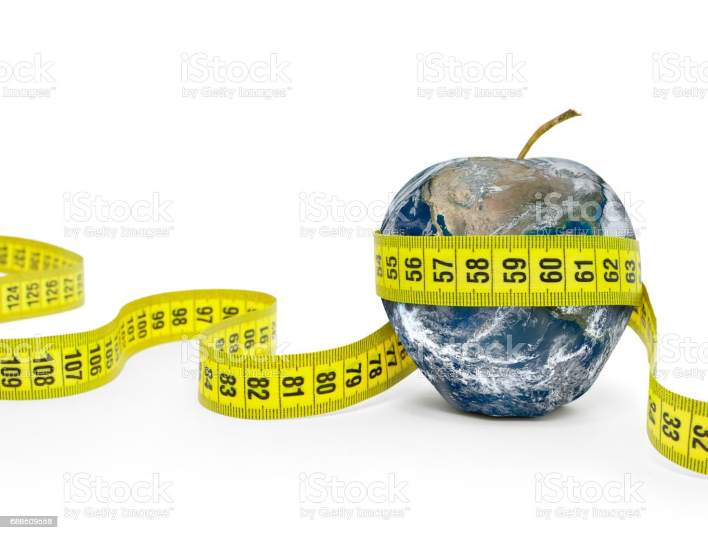 Planet in shape of an apple Wrapped in Measuring tape. stock photo