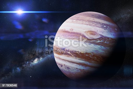 istock planet Jupiter in front of the galaxy and the Sun 917806546