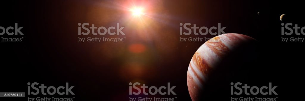 planet Jupiter with moons in front of the Sun stock photo