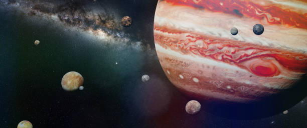planet Jupiter with some of the 69 known moons with the galaxy artist's interpretation of the stormy gas giant with the red dot known gas stock pictures, royalty-free photos & images