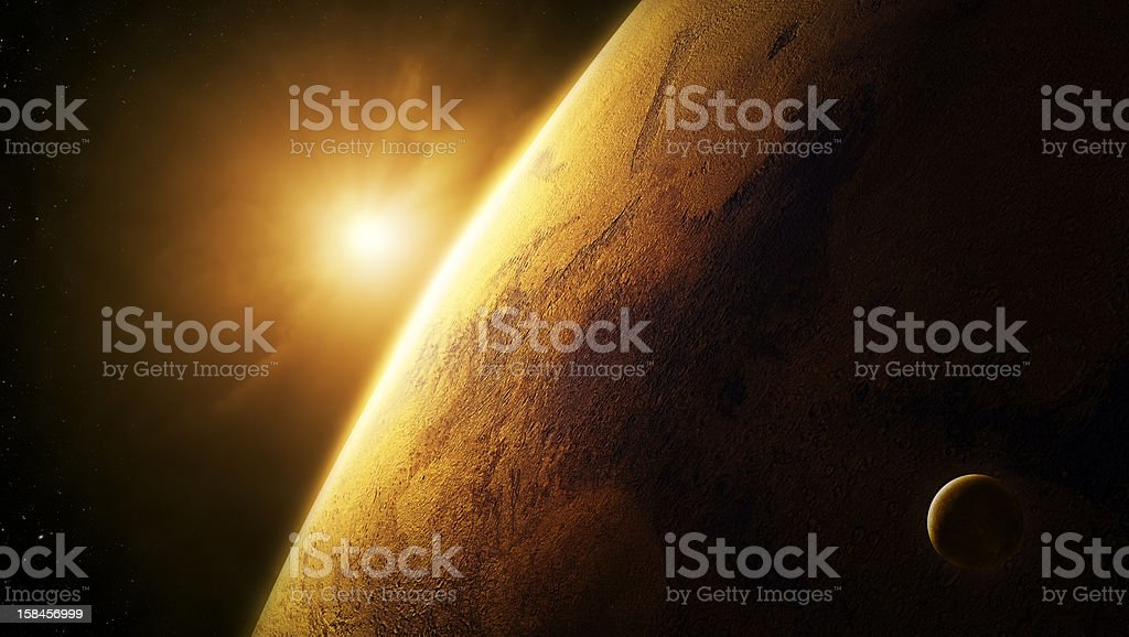 Planet Mars close-up with sunrise in space stock photo