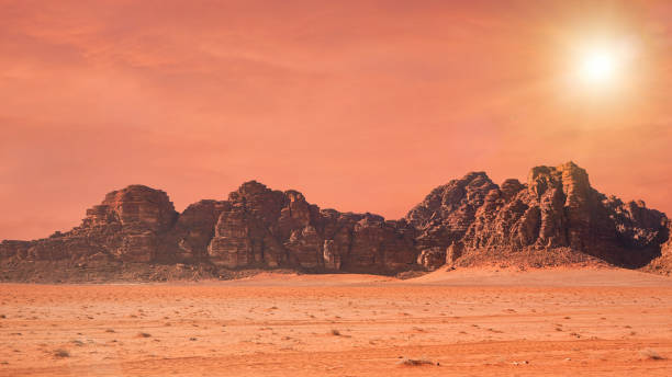 Planet Mars like landscape - Photo of Wadi Rum desert in Jordan with red colour filter and added sun, this location was used as set for many science fiction movies stock photo