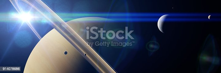 istock planet Saturn with moon Enceladus and other moons in front of the Sun 914078686