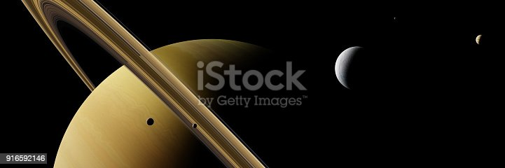 istock planet Saturn with moon Enceladus and other moons 916592146