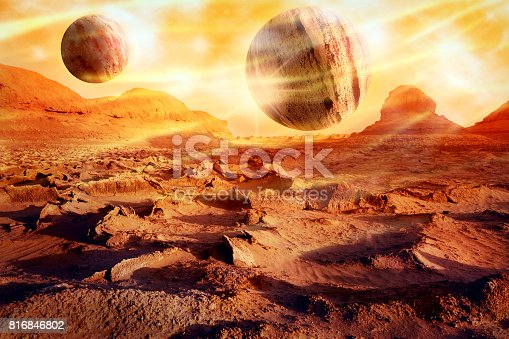 istock Planets over a lifeless desert. Space landscape in red-yellow tones. Alien planet concept. Artistic image. 816846802