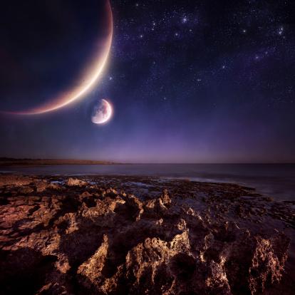Rising planets over sea. Night shot.