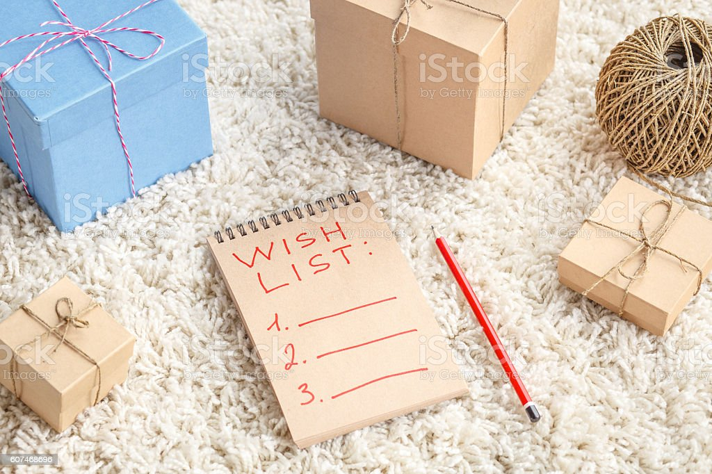 Planing gifts for Christmas with wish list stock photo