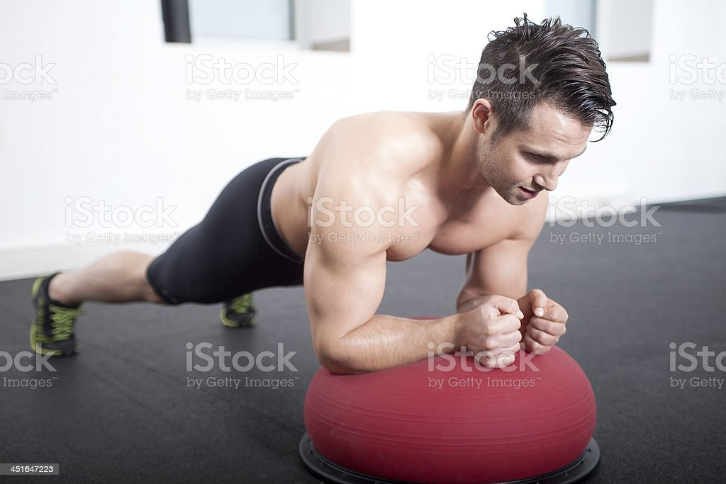 Plank on Bosu Gymnastic Ball royalty-free stock photo