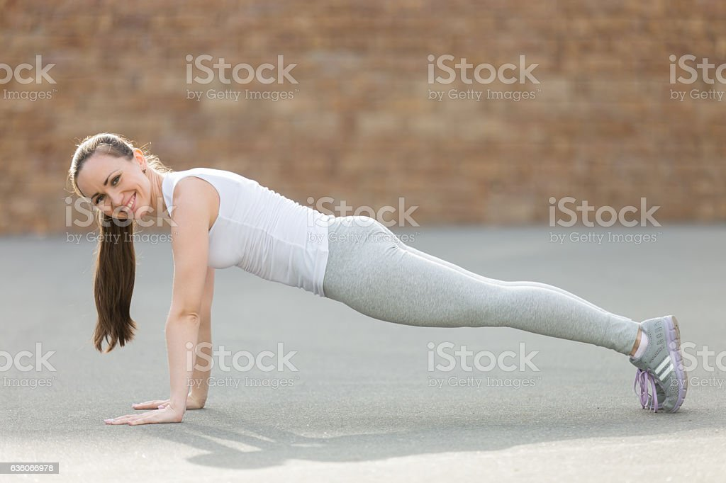Plank pose, looking at the camera stock photo