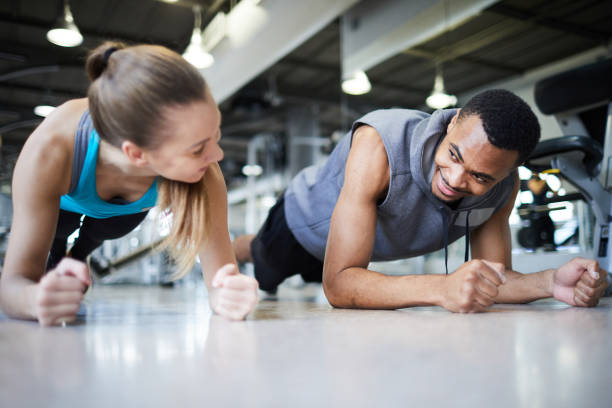 Planks in gym stock photo