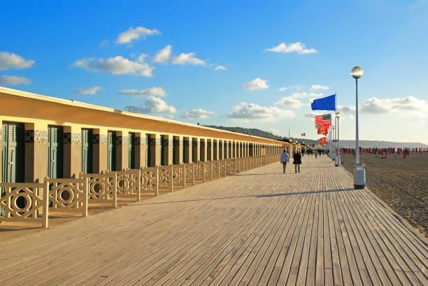 Planks of Deauville Planks of Deauville on background of setting sun boardwalk stock pictures, royalty-free photos & images