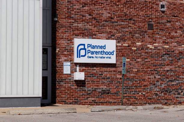 Planned Parenthood location. Planned Parenthood provides reproductive health services in the US VI Champaign - Circa August 2019: Planned Parenthood location. Planned Parenthood provides reproductive health services in the US VI planned parenthood federation of america stock pictures, royalty-free photos & images