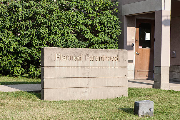 Planned Parenthood Sign From Louisville, Kentucky Louisville, Kentucky, USA - August 16, 2015:  Planned Parenthood sign in front of the Louisville, Kentucky Planned Parenthood building. planned parenthood federation of america stock pictures, royalty-free photos & images