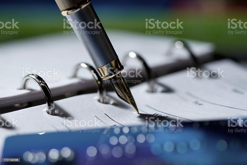 Planner, pen and credit card stock photo