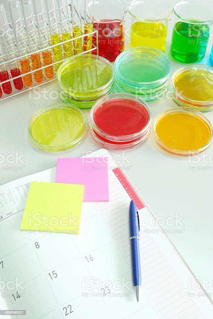 planner with colorful fluid in glassware stock photo