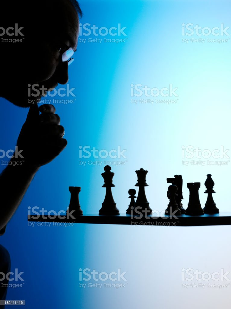 Planning a Game of Chess royalty-free stock photo