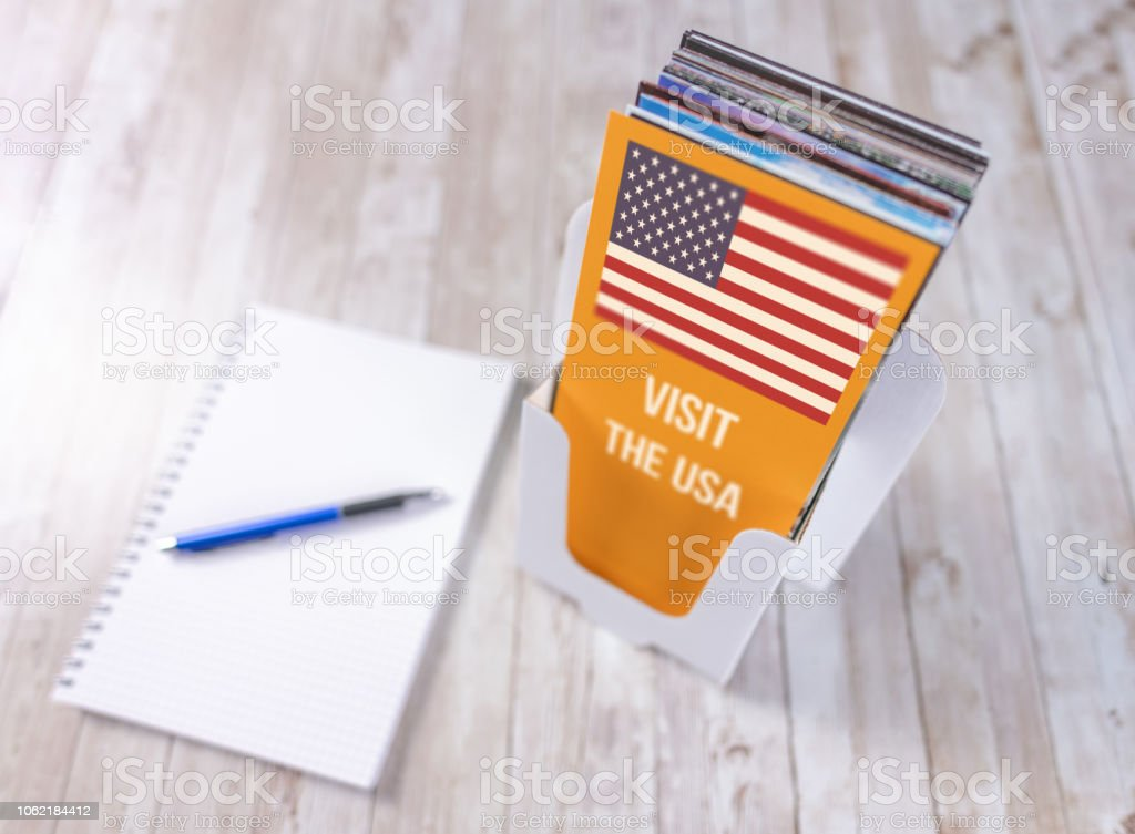 Planning a trip to the USA with a leaflet holder and pen and paper stock photo