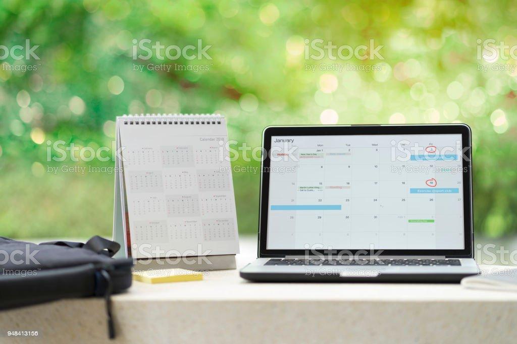 Planning agenda and schedule using calendar event planner on computer laptop. Calender planner organization management remind concept. stock photo