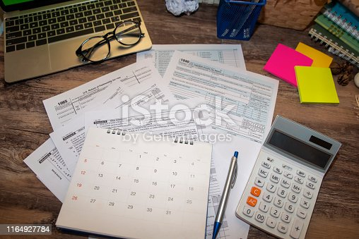 istock Planning Budget Concept.Calendar 2019 and Individual Income Tax Form For who have income According to United States law.This is the season that has to pay taxes,deadline of tax payment. 1164927784