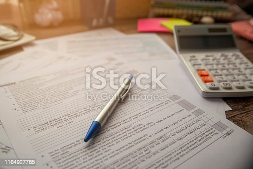 istock Planning Budget Concept.Calendar 2019 and Individual Income Tax Form For who have income According to United States law.This is the season that has to pay taxes,deadline of tax payment. 1164927785