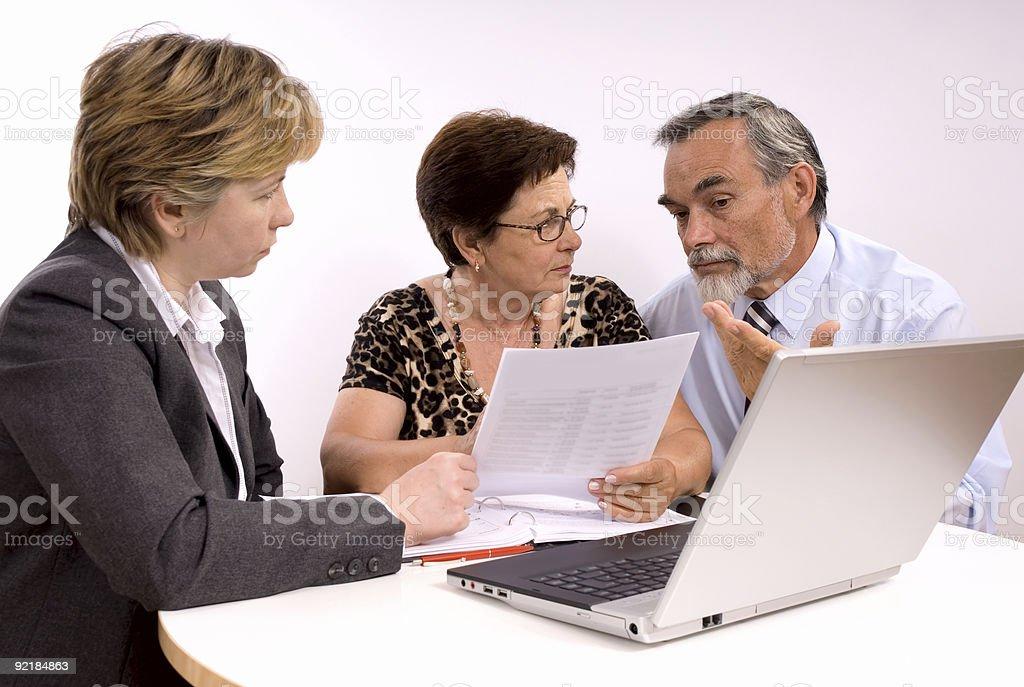 Planning finances around a laptop royalty-free stock photo