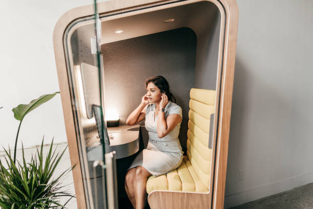 Planning for a new world. Multiethnic woman on her video chat with online  team stock photo