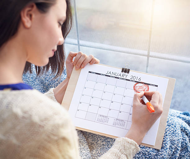 planning her day - calendar date stock photos and pictures