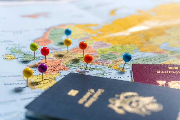 Planning Holidays Maps with pins and passports, planning the holidays. citizenship stock pictures, royalty-free photos & images