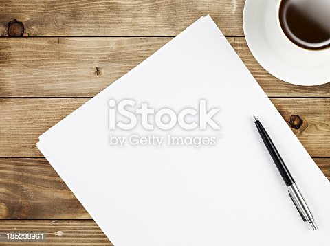 Directly above view of a table with papers and a coffee mug on it