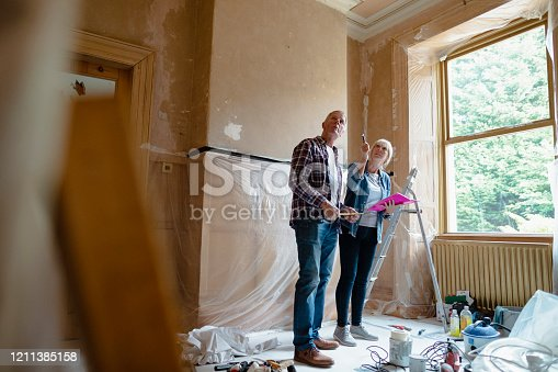 Senior couple planning room renovation.